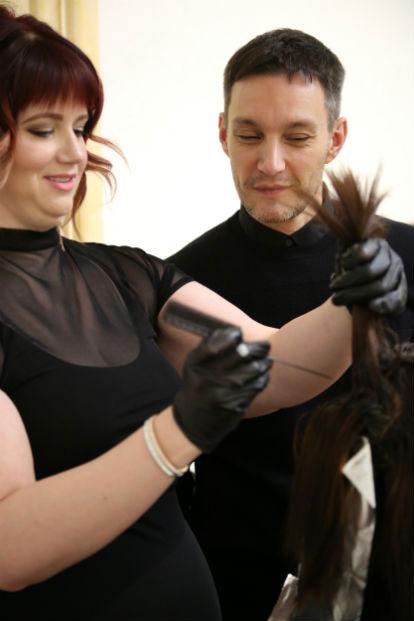 Ian looks on as #avedaartist instagram challenge winner Sarah Sibley begins a new color look | Source: Aveda