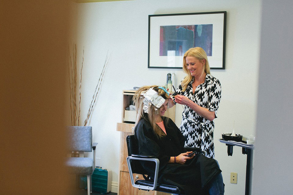 A Salon U stylist puts color in a client's hair. Photo by Graham Yelton.